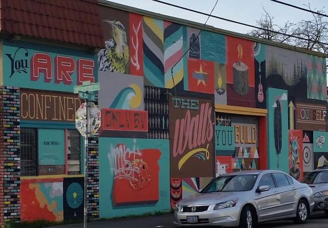 """Mural on the side of the building in Portland that says """"You are confined only by the walls you build yourself."""""""