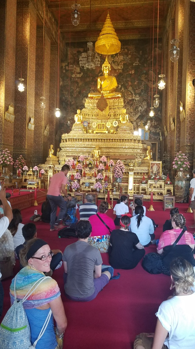 9 Helpful Lessons for Visiting Thailand #8 - Avoid Conflict. Paying respects at a temple in Bangkok