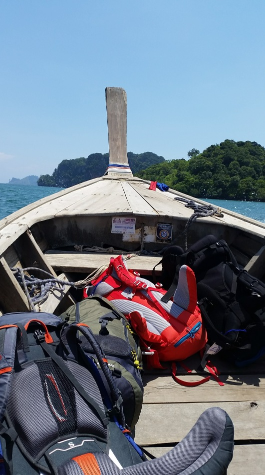 9 Helpful lessons for visiting thailand #1 - Pack lightly! Photo of our hiking packs at the front of a longtail boat.